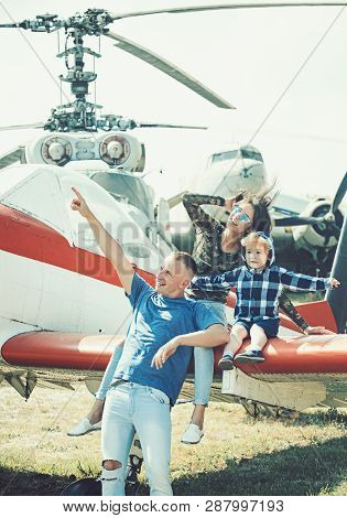 Flight Ahead. Helicopter Tour And Travel. Family Vacation. Family Couple With Child On Vacation Trip