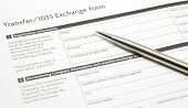 A generic annuity or investment Section 1035 Exchange Paper Form waiting to be filled out with a silver pen. poster