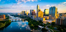 Aerial Drone View Of Austin Texas Skyline At Sunrise Over Lady Bird Lake With Perfect Reflection Off