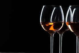 Glass Of Red, Rose And White Wine Over Black Background. Wine Card Menu Design. Closeup Of Wineglass