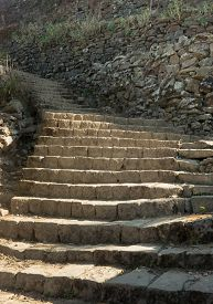 An Old Grungy Stone Staircase Goes Up A Mountain Or Hill Side