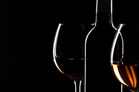 Elegant Wine Bottles And Wine Glass In A Black Background