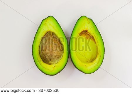 Open Avocado On A White Background. Avocado Macro. Close Up Of An Avacado. Avocado Isolated On White
