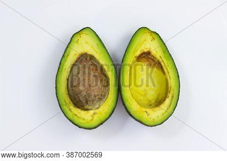 Open Avocado On A White Background. Avocado Macro. Close Up Avacado. Avocado Isolated On White Backg