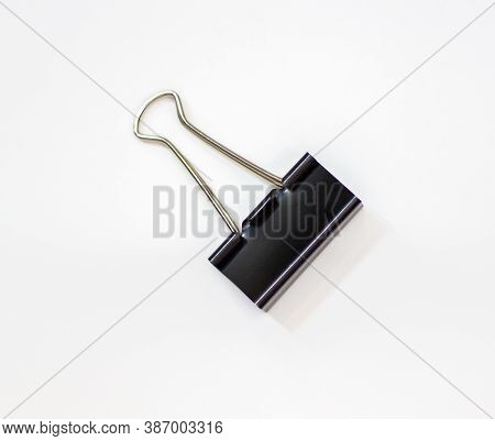 Clip For Papers. Binding Of Papers, Office Supplies. Binder For Papers On A White Background