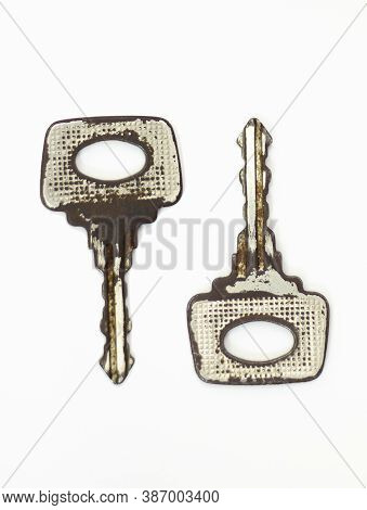 Old Key Isolated. Keys On Table. Ancient Keys, Used For Long Time. Vintage Key On White Background.