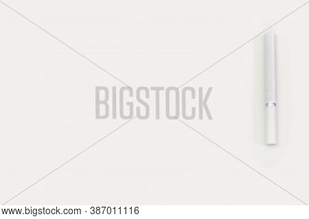 White Cigarette On A White Background. A Cigarette For Smoking On A White Background. Dependence