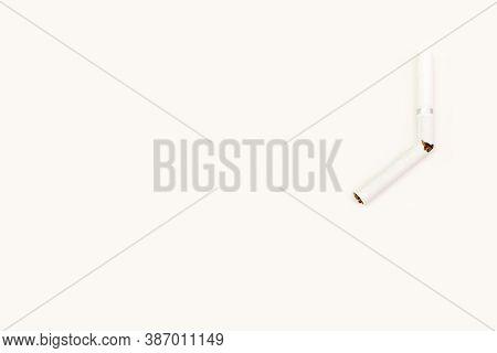 Broken Cigarette. White Cigarette On A White Background. A Cigarette For Smoking On A White Backgrou