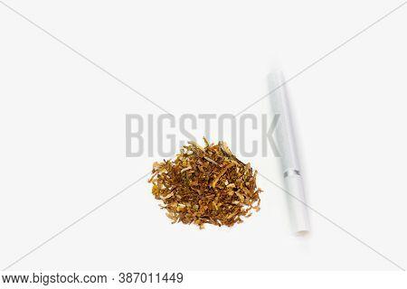 Cigarette And Tobacco On White Background. White Cigarette On Table. Dry Tobacco Leaves On White Bac
