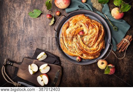 Fresh Homemade Twisted Pie With Apple And Cinnamon Filling In Vintage Tray On Rustic Plywood Backgro