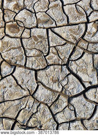 Dried Mud Texture. Dried Dirt, Background. Yellow Ground