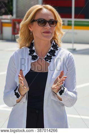 Bucharest, Romania - June 26, 2020 Gabriela Firea, the mayor of Bucharest, and Daniel Baluta, the mayor of sector 4, not in picture, inaugurate a multi-storey car parking, in the Berceni neighborhood.