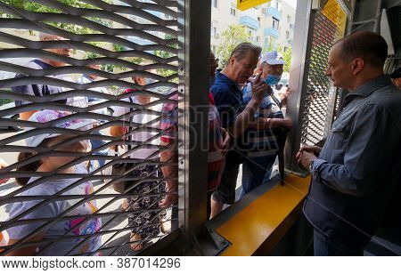 Bucharest, Romania - June 26, 2020 Daniel Baluta, the mayor of sector 4, talk to people at the inauguration of a multi-storey car parking, in the Berceni neighborhood of Bucharest.