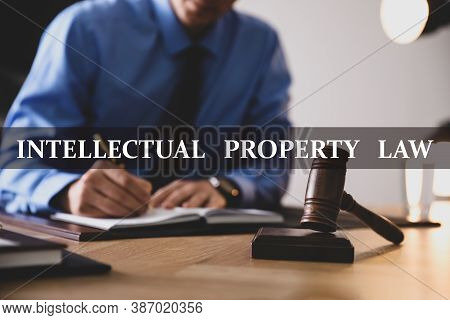 Intellectual Property Law. Jurist Working At Table In Office, Focus On Gavel