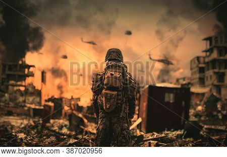 A Soldier Watching Forces And Helicopters In The Sky Top Of Destroyed City
