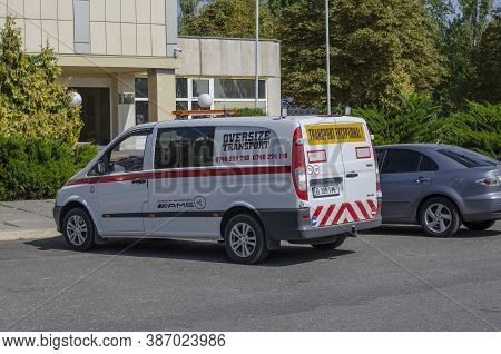 Nikolaev, Ukraine - September 19, 2020: Pilot Vehicle Escorting Oversize Transports In The Parking L