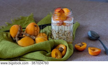 Loquats And Overnight Oats On Brown Table And Green Tablecloth, Swith Copy-space, Viewed From An Agl