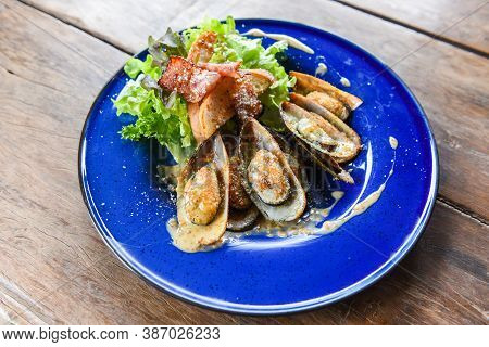 Grilled Mussel Shell Ham Vegetables And Sauce Seafood Served On Table / Shellfish Seafood Plate Fres