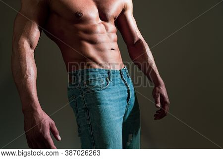 Closeup Photo Of An Athletic Guy With Perfect Abs. Guy With A Naked Torso. Handsome Muscular Man Wit