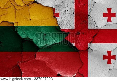 Flags Of Lithuania And Georgia Painted On Cracked Wall