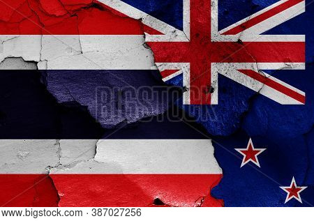 Flags Of Thailand And New Zealand Painted On Cracked Wall