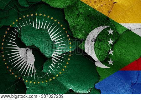 Flags Of African Union And Comoros Painted On Cracked Wall