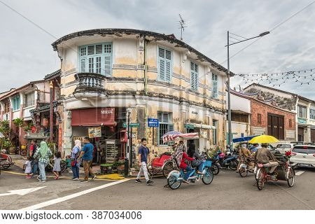George Town, Penang, Malaysia - December 1, 2019: Street Life With Classic Local Rickshaw In George