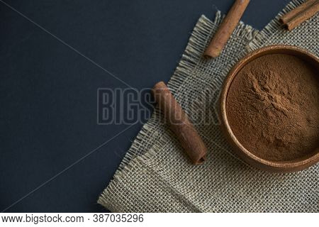 Cinnamon Sticks, Tied With Jute Rope In Rustic Style. Ground Cinnamon In A Wooden Bowl And Vintage S