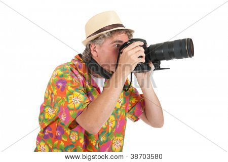 Typical tourist with big camera taking pictures