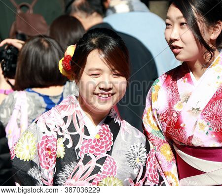 Fushimi-ku, Kyoto, Japan, November 17, 2017 : Two Woman In Kimono Dress Among Tourist At Fushimi Ina