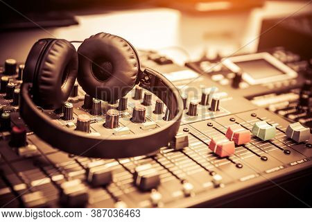 Headphone With Audio Mixer In Studio Workplace For Lives The Media And Sound Recording Equipment And