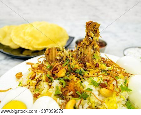 Closeup Of A Chicken Biryani Plate On White Marble Floor