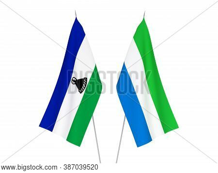 National Fabric Flags Of Sierra Leone And Lesotho Isolated On White Background. 3d Rendering Illustr