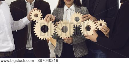 Company Employees Joining Gearwheels As Metaphor For Effective Business Management And Teamwork