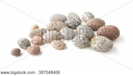 Sea Smooth Oval Pebbles Isolated On White Background. Group Of Stacked Round Pebbles.