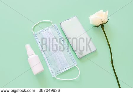 Top View Of Blue Surgical Protective Mask, Smartphone, Liquid Antimicrobial Spray - Mockup Of Unbran
