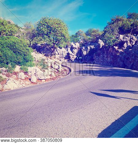 Winding Asphalt Road In The Cantabrian Mountains, Spain, Vintage Style Toned Picture