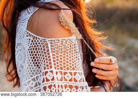 Beautiful Boho Woman In A Sunny Field At Sunset.