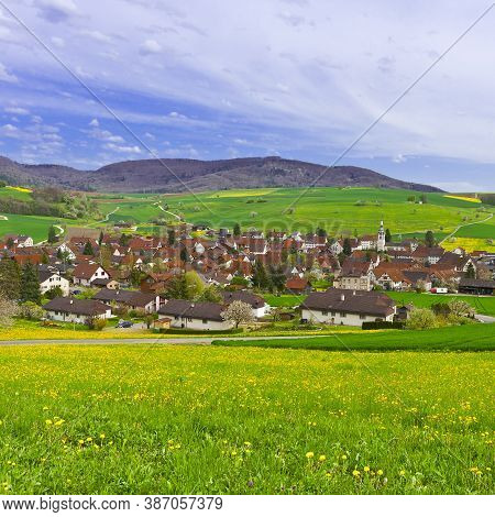 The Small Swiss Town Surrounded By Pastures