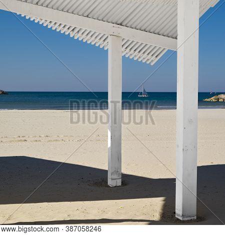 Sunshade On The Beach Of Mediterranean Sea In Israel
