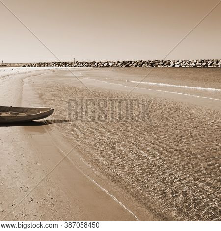 Rubber Inflatable Boat On The Beach Of Mediterranean Sea In Israel, Vintage Style Sepia