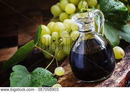 Balsamic Vinegar In A Glass Jug, Vintage Wooden Background, Rustic Style, Selective Focus