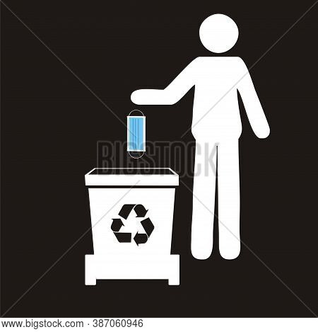 Hand Throwing Away Used Protective Face Mask In Trash Bin. Garbage Bin For Biohazard Waste. Safely D