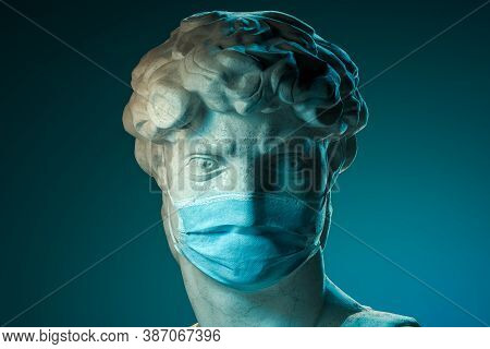 Head Bust Classical Sculpture Wearing Protecting Face Mask Against Virus On Blue Background Illumina