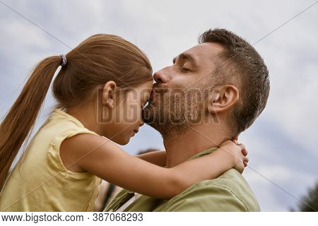 My Little Girl. Young Loving Father Kissing His Cute Daughter In Forehead While Spending Time Togeth