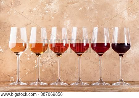 Rose Wine Glasses Assortment On Wine Tasting. Degustation Different Varieties, Colors And Shades Of