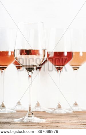 Rose Wine Glasses Set On Wine Tasting. Tasting Different Varieties, Colors And Shades Of Pink Wine C