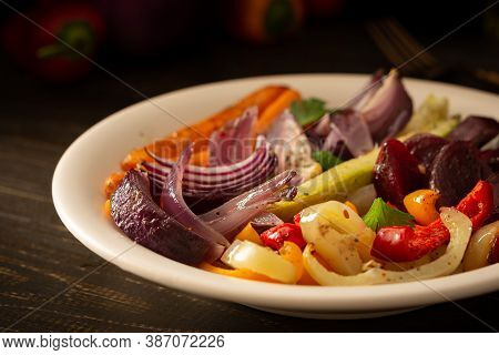 Stewed Vegetables In A Plate, Carrots With Garlic And Red Onions, Zucchini With Bell Pepper And Beet