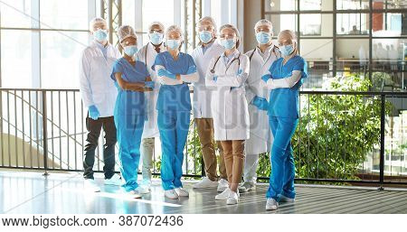 Team Of Mixed-races Team Of Professional Males And Females Doctors In Hospital. Indoor. Internationa