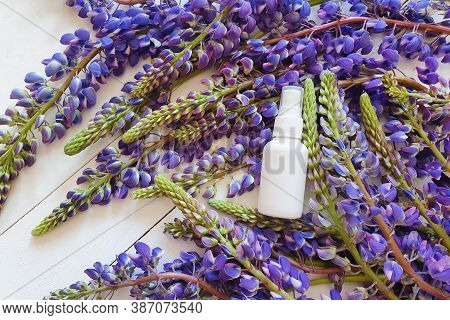 Top View And Close-up Of Unbranded White Plastic Spray Bottle Mockup And Lupine Flowers On A White W